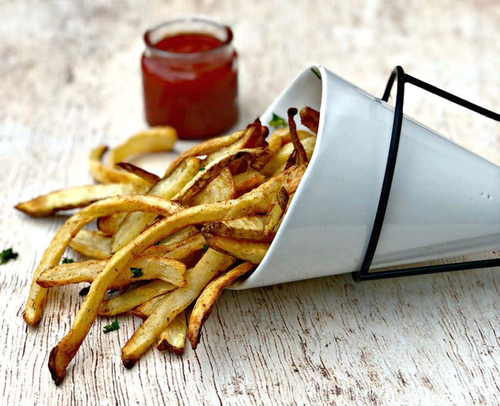 air fryer fries in a white can with ketchup